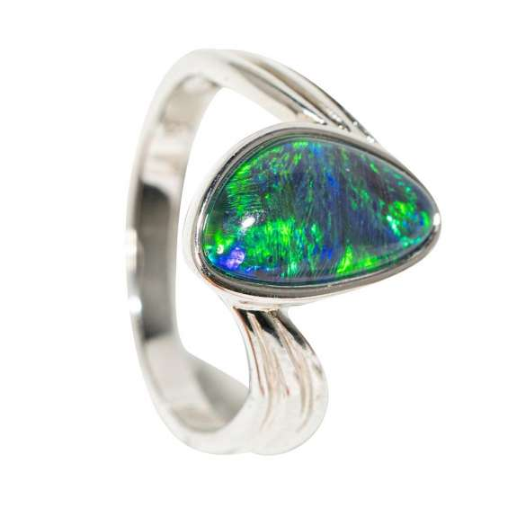 This dazzling sterling silver australian opal ring features a brushtroke pattern of deeply rich green and clue flashes that flow throughout the gemstone. a reminder that this is an incredible work of art by mother nature herself, perfect for a one of a ki
